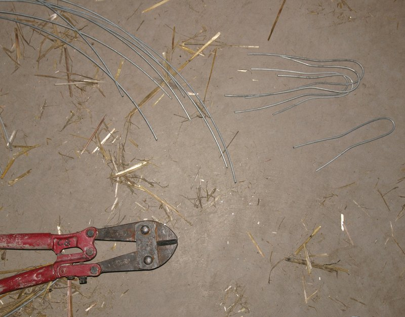 Bale pins made from 12 gauge fencing wire. Note double bend for grip in wall.