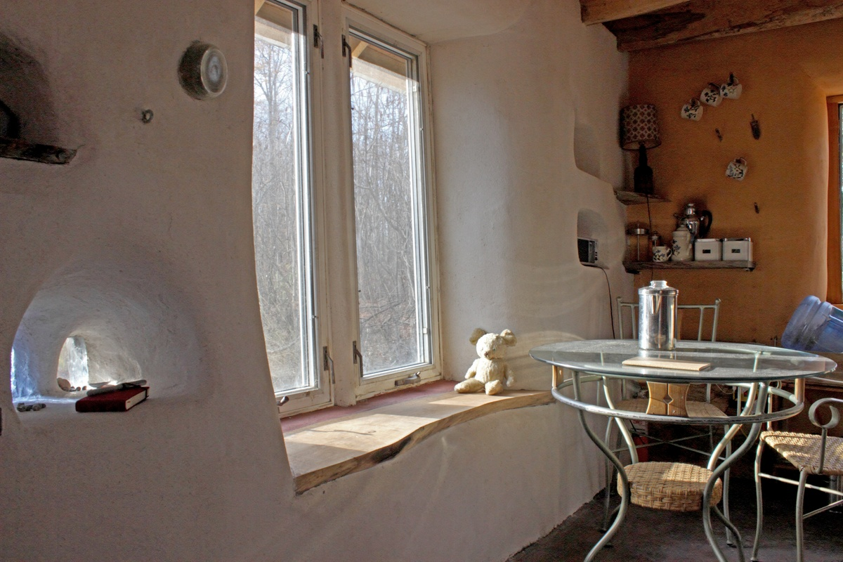 Inside cabin, earth plasters and butternut window ledge